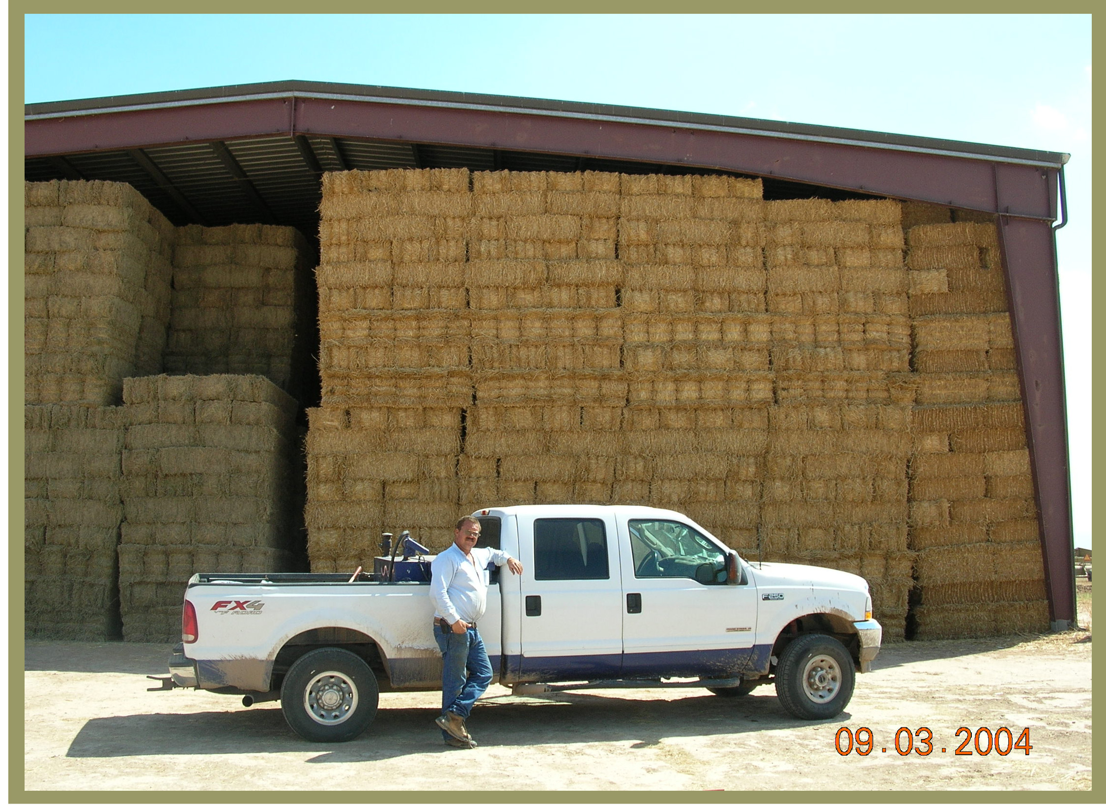 Ronald Leimgruber in front of his hay barns